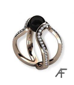 skulptural ring i 18 k guld med onyx och diamanter