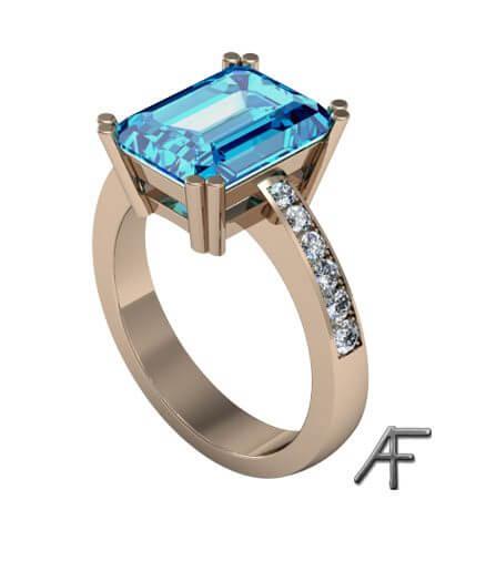 guldring med blå topas och diamanter