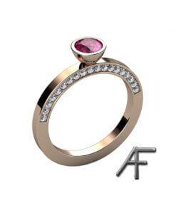 18 k guldring med rosa safir och fadeninfattade diamanter