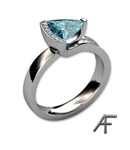 ring med diamanter och blå zirkon
